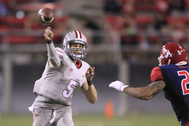 UNLV quarterback Blake Decker fires a pass against  Fresno State Friday, Oct. 10, 2014 at Sam Boyd Stadium. UNLV won the game in overtime 30-27. (Sam Morris/Las Vegas Review-Journal)