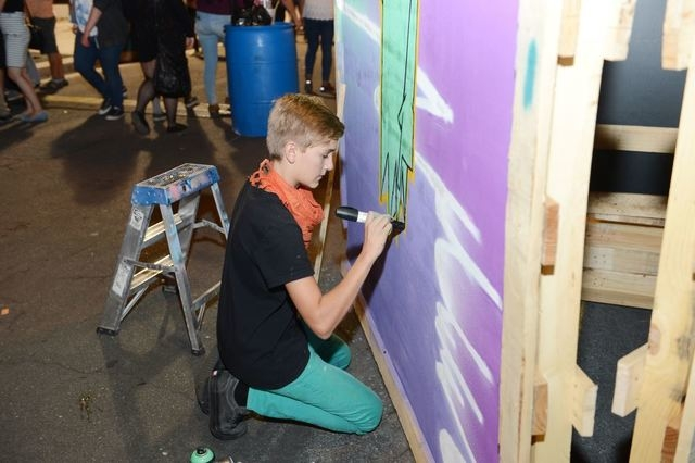 Student artist Sean Barilleaux, 14, paints adjacent to artist mentor Juan Muniz during Wynn Resorts Oct. 3 partnership event with The First Friday Foundation. (Special to View)