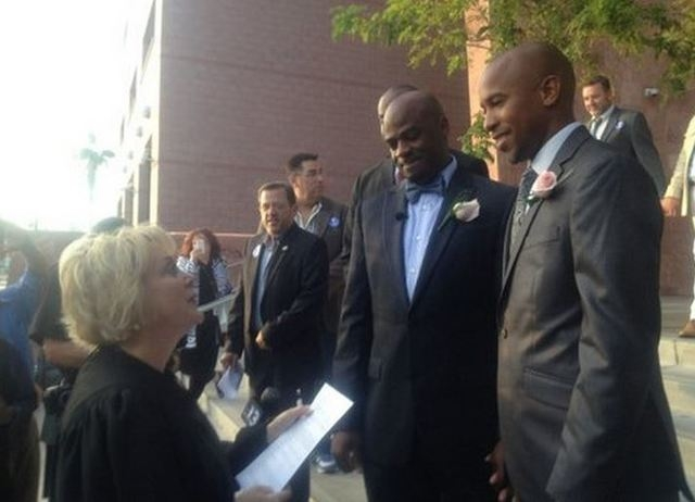 Judge Nancy Allf conducts the first legal same-sex wedding in Las Vegas history on Thursday, Oct. 9, 2014. (@ClarkCountyNV/Twitter)