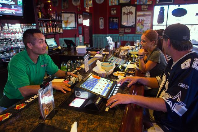 Juan Rojas, left, talks with customers at Juan's Flaming Fajitas & Cantina, located at 9640 W. Tropicana Ave. Saturday, Sept. 27, 2014. (Samantha Clemens-Kerbs/Las Vegas Review-Journal)