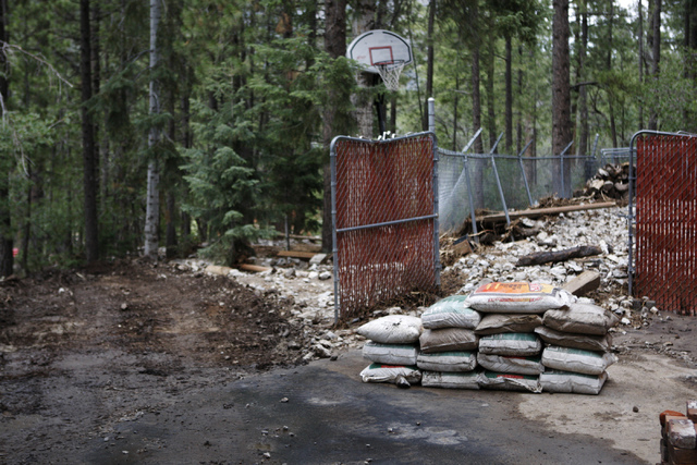 Sands bags are seen at the home of Ron Erskine after a flood damaged his home at the Rainbow Canyon subdivision at Mount Charleston Wednesday, July 30, 2014. (Erik Verduzco/Las Vegas Review-Journal)