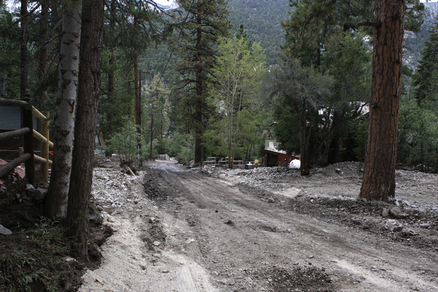 Road damage is seen after a flood at the Rainbow Canyon subdivision at Mount Charleston Wednesday, July 30, 2014. (Erik Verduzco/Las Vegas Review-Journal)