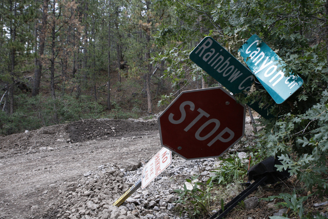 Road damage is seen at the corner of Canyon Circle and Rainbow Boulevard after a flood at the Rainbow Canyon subdivision at Mount Charleston Wednesday, July 30, 2014. (Erik Verduzco/Las Vegas Revi ...