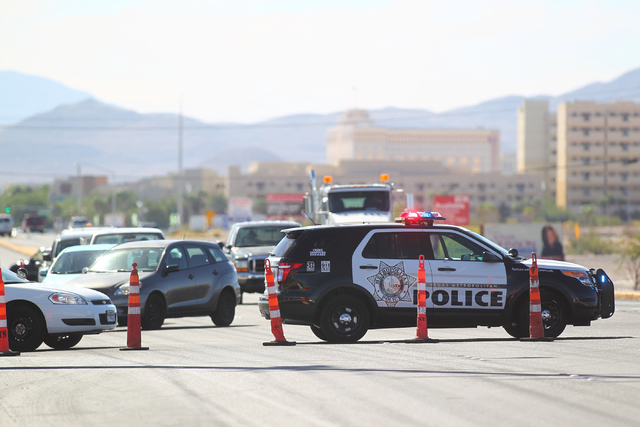 Las Vegas Boulevard is shut down as crews work on cleaning up the area after a gas leak, near Warm Springs Road, across from the Las Vegas Premium Outlets - South, in Las Vegas on Wednesday, Oct.  ...