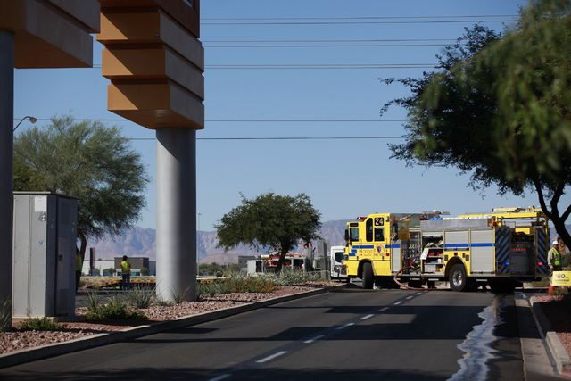 A Clark County fire engine is seen as gas crews work on cleaning up the area after a gas leak on Las Vegas Boulevard shut the road down, near Warm Springs Road, across from the Las Vegas Premium O ...