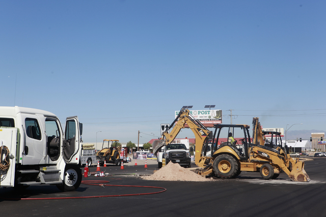 Crews work on cleaning up the area after a gas leak on Las Vegas Boulevard shut the road down, near Warm Springs Road, across from the Las Vegas Premium Outlets - South, in Las Vegas on Wednesday, ...