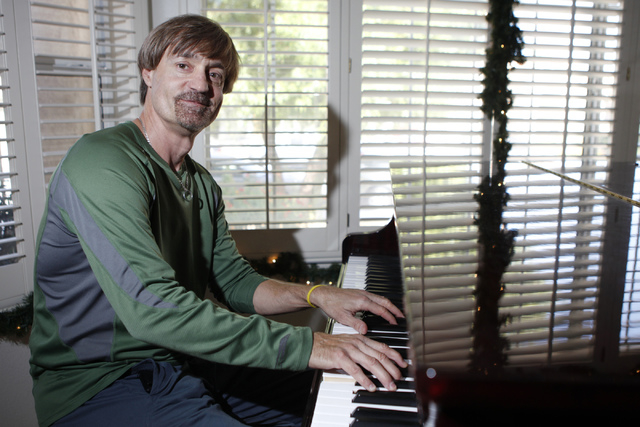 """Michael Dubay, musical director for the play, """"I know I came in here for something,"""" poses for a portrait at Hattie's House,  9109 Lazy Hill Circle, Saturday, Oct. 11, 2014. (Erik Verduz ..."""