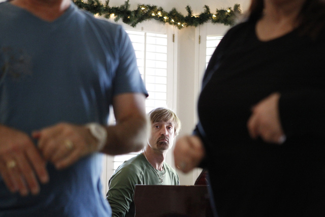 """Michael Dubay, musical director for the play, """"I know I came in here for something,"""" watches cast members rehearse as he plays the piano at Hattie's House,  9109 Lazy Hill Circle, Saturd ..."""