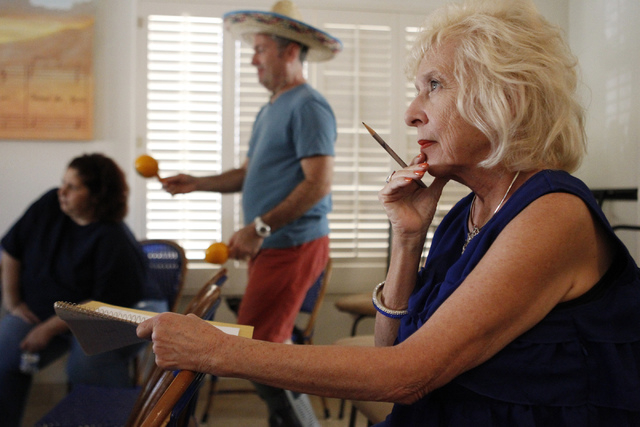 """Camille Duskin, director for the the play, """"I know I came in here for something,"""" watches her cast members rehearse at Hattie's House,  9109 Lazy Hill Circle, Saturday, Oct. 11, 2014. (E ..."""