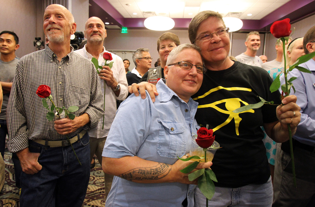 Jefferson Ruck, from left, his partner Thomas Topovski, Tina Reynolds and her wife Dee Reynolds celebrate the 9th U.S. Circuit Court of Appeals on ruling Tuesday, Oct. 7, 2014, finding Nevada's ba ...