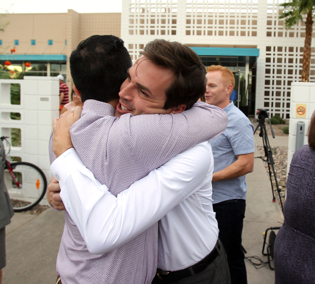 Raul Daniels, left, hugs Marek Bute to celebrate the 9th U.S. Circuit Court of Appeals on ruling Tuesday, Oct. 7, 2014, finding Nevada's ban on same-sex marriage unconstitutional during a gatherin ...