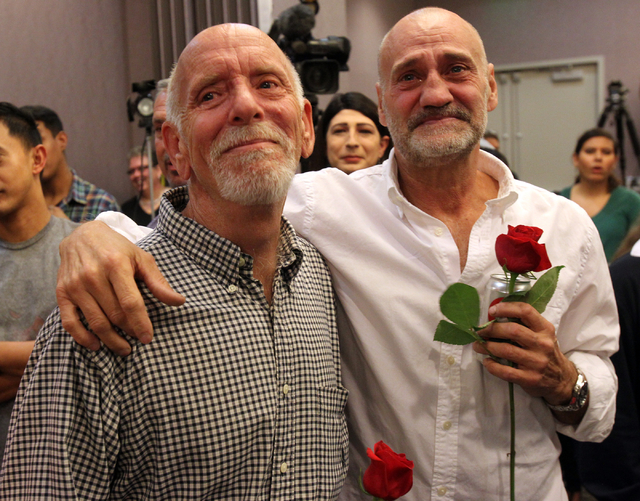 Jefferson Ruck, left, and his partner Thomas Topovski get emotional during a gathering at The Center in Las Vegas to celebrate the 9th U.S. Circuit Court of Appeals on ruling Tuesday, Oct. 7, 2014 ...