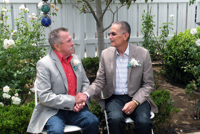 Fred McQuire, left, and George Martinez pose for photos at their July 2014 wedding in California. Martinez was a Vietnam War veteran in the final stages of cancer when he and McQuire, his partner  ...