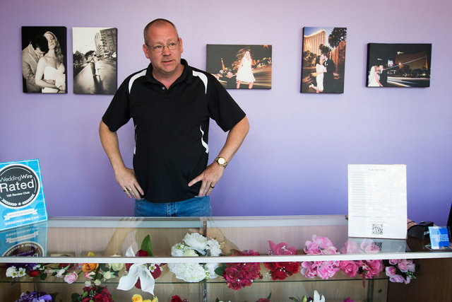 Jim McGinnis, owner of Chapelle De L'Amour, waits for couples at his wedding chapel located one block from the Clark County Marriage License Bureau on Wednesday, Oct. 8, 2014. On Thursday, Oct. 9, ...