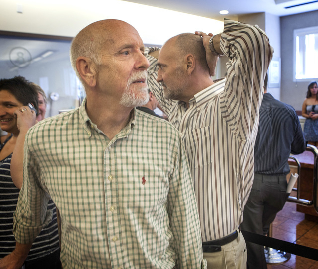Jefferson Ruck, left, and Thomas Topovski waits in line to get a marriage license at the Clark County Marriage License Bureau at the Regional Justice Center on Wednesday, Oct. 8, 2014. U.S. Suprem ...