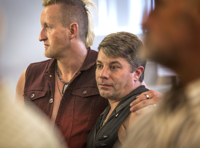 Dave Parry, left, and Morgan Ford waits in line to get a marriage license at the Clark County Marriage License Bureau at the Regional Justice Center on Wednesday, Oct. 8, 2014. U.S. Supreme Court  ...