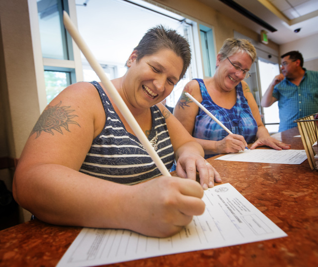 Tara Traynor, left, and Cathy Grimes fills out  a marriage license at the Clark County Marriage License Bureau at the Regional Justice Center on Wednesday, Oct. 8, 2014. U.S. Supreme Court tempora ...