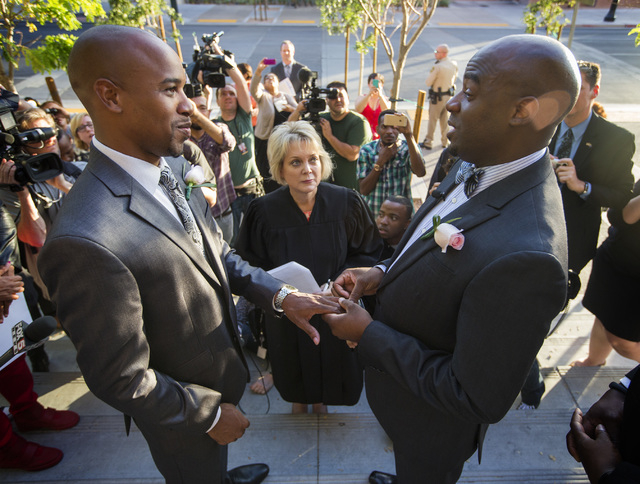 Sherwood Howard, left, and his husband Nevada Sen. Kelvin Atkinson, get married by District Court Judge Nancy Alf on the steps of the Regional Justice Center on Thursday, Oct. 9, 2014.  They were  ...