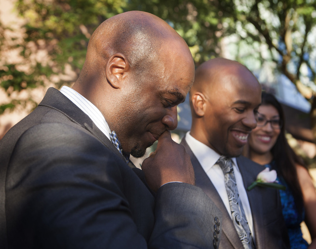 Nevada Sen. Kelvin Atkinson, left, and Sherwood Howard get married on the steps of the Regional Justice Center on Thursday, Oct. 9, 2014.  They were the first same-sex couple to get married in Cla ...