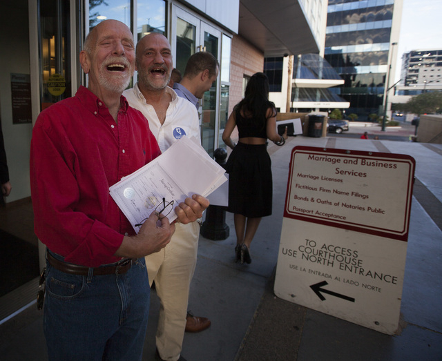Jefferson Ruck, left, and Thomas Topovski exit  County License Bureau after receiving their marriage license on Thursday, Oct. 9, 2014.  Today is the first for  same-sex couples to get married in  ...