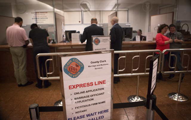 Same-sex couples get marriage licenses at the  County License Bureau  on Thursday, Oct. 9, 2014.  Today is the first for  same-sex couples to get married in Clark County. (Jeff Scheid/Las Vegas Re ...