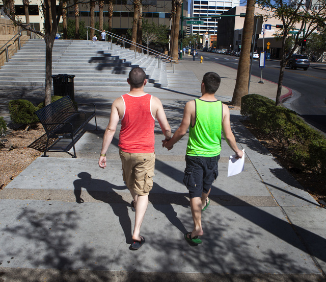 Ray Huntington,left, and Atrua Stoller from Pasco, Wash. walks pass the Regional Justice Center after getting their marriage licenses on Friday, Oct. 10, 2014.  The couple found out that same-sex  ...