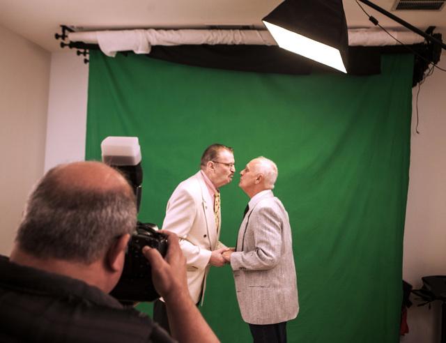 Wedding photographer Doug Von Heeder,left, takes photos Peter Schmitt, 74,and James Hook,65,  after the couple got  married at Chapelle De L'Amour, 255 E. Bonneville Avenue on Friday, Oct. 10, 201 ...