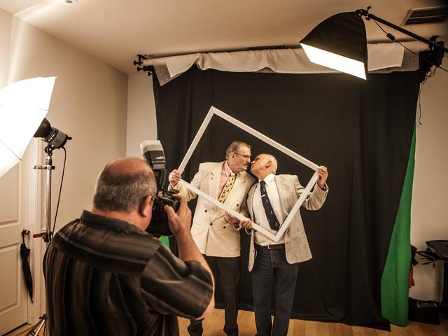 Wedding photographer Doug Von Heeder,left, takes photos Peter Schmitt, 74,and James Hook, 65,  after the couple got  married at Chapelle De L'Amour, 255 E. Bonneville Avenue on Friday, Oct. 10, 20 ...