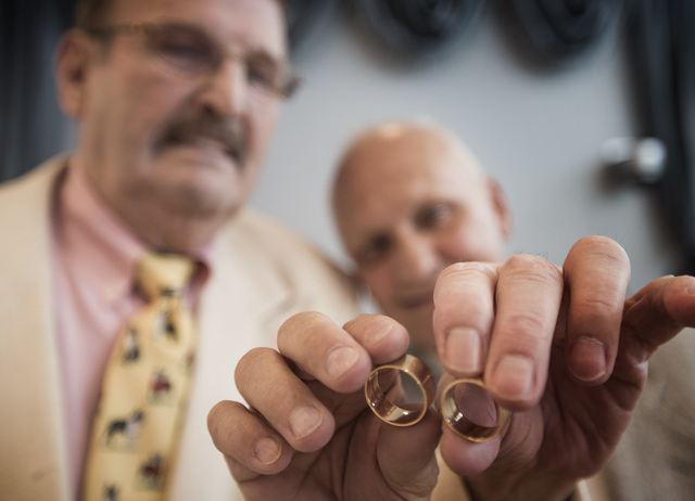 Peter Schmitt,left, 74,and James Hook,65, hold their rings before getting married at Chapelle De L'Amour, 255 E. Bonneville Avenue on Friday, Oct. 10, 2014.  The Las Vegas couple have  been togeth ...