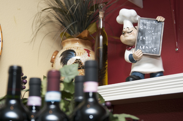 A chef figurine is seen decorating the wall at Gina's Bistro. (Erik Verduzco/Las Vegas Review-Journal)