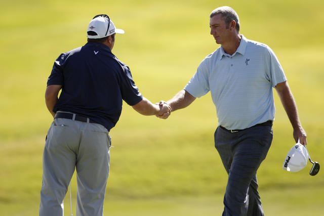 Andrew Svoboda, left, and Bill Lunde, shake hands after completing the course in the second round of the Shriners Hospitals for Children Open golf tournament at TPC Summerlin, 1700 Village Center  ...