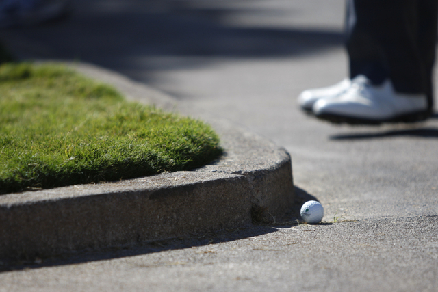 Bill Lunde's ball sits on the pedestrian pathway on the 9th green during his last hole in the second round of the Shriners Hospitals for Children Open golf tournament at TPC Summerlin, 1700 Villag ...