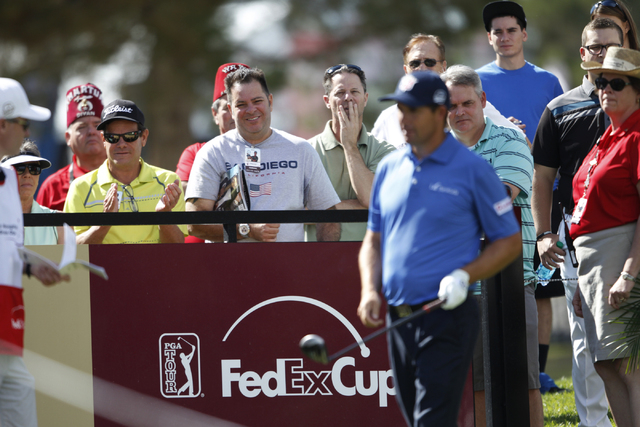Spectators watch as Padraig Harrington gets ready to start his game from the 10th tee in the Shriners Hospitals for Children Open golf tournament at TPC Summerlin, 1700 Village Center Circle, in L ...