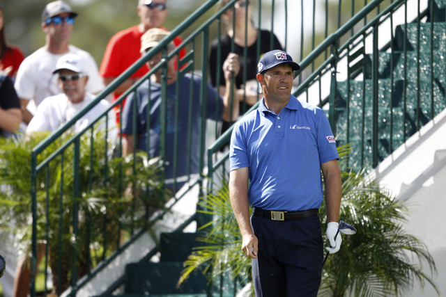 Padraig Harrington watches his ball from the 10th tee in the Shriners Hospitals for Children Open golf tournament at TPC Summerlin, 1700 Village Center Circle, in Las Vegas Thursday, Oct. 16, 2014 ...