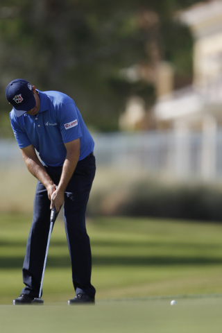 Padraig Harrington putts the ball on the 10th green during the Shriners Hospitals for Children Open golf tournament at TPC Summerlin, 1700 Village Center Circle, in Las Vegas Thursday, Oct. 16, 20 ...