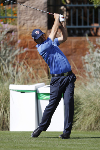 Padraig Harrington hits the ball from the 11th tee in the Shriners Hospitals for Children Open golf tournament at TPC Summerlin, 1700 Village Center Circle, in Las Vegas Thursday, Oct. 16, 2014. ( ...