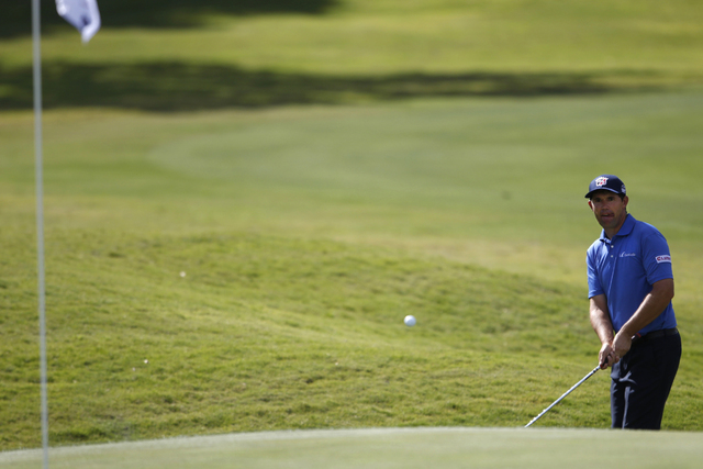 Padraig Harrington hits the ball on the 11th green in the Shriners Hospitals for Children Open golf tournament at TPC Summerlin, 1700 Village Center Circle, in Las Vegas Thursday, Oct. 16, 2014. ( ...