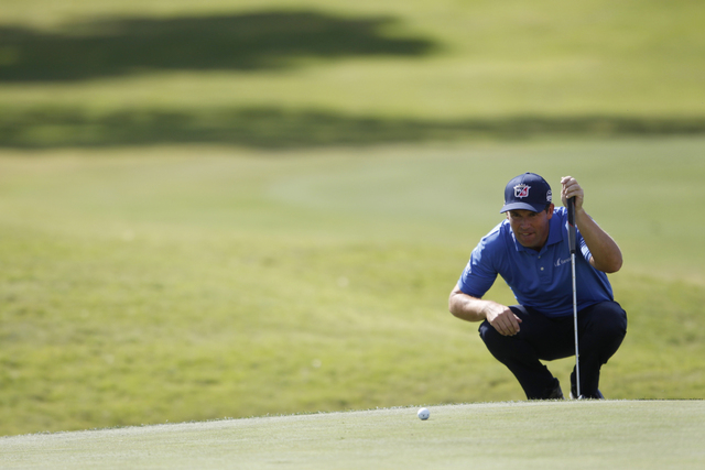 Padraig Harrington gets ready to hit the ball on the 11th green in the Shriners Hospitals for Children Open golf tournament at TPC Summerlin, 1700 Village Center Circle, in Las Vegas Thursday, Oct ...