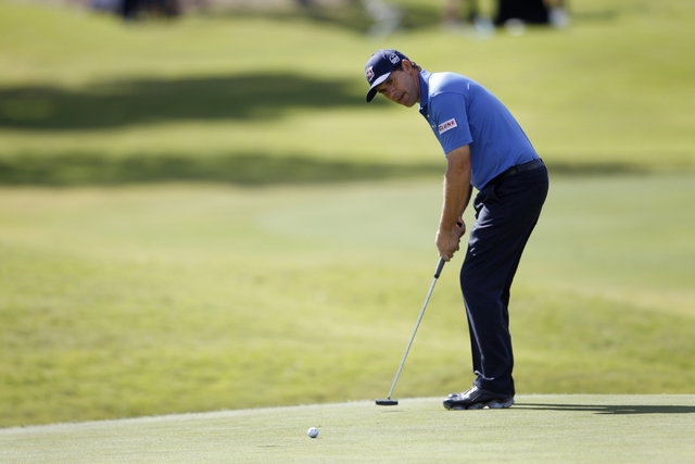 Padraig Harrington putts the ball on the 11th green in the Shriners Hospitals for Children Open golf tournament at TPC Summerlin, 1700 Village Center Circle, in Las Vegas Thursday, Oct. 16, 2014.  ...