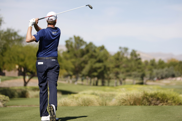 Webb Simpson hits a drive ball from the seventh tee in the second round of the Shriners Hospitals for Children Open golf tournament at TPC Summerlin, 1700 Village Center Circle, in Las Vegas Frida ...