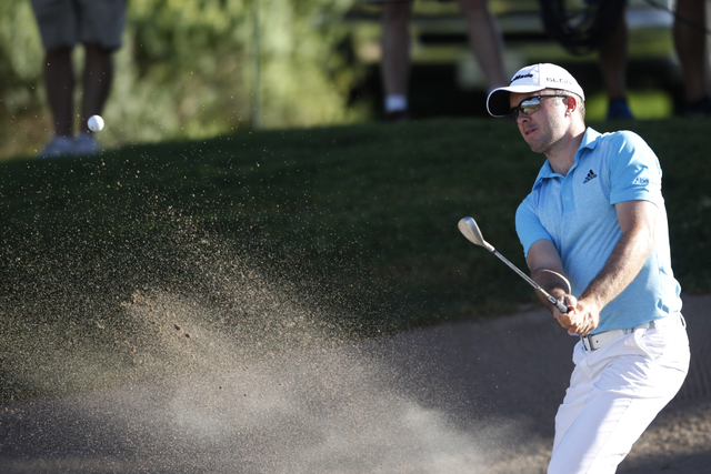 Martin Laird hits the ball from a bunker on the third green in the second round of the Shriners Hospitals for Children Open golf tournament at TPC Summerlin, 1700 Village Center Circle, in Las Veg ...