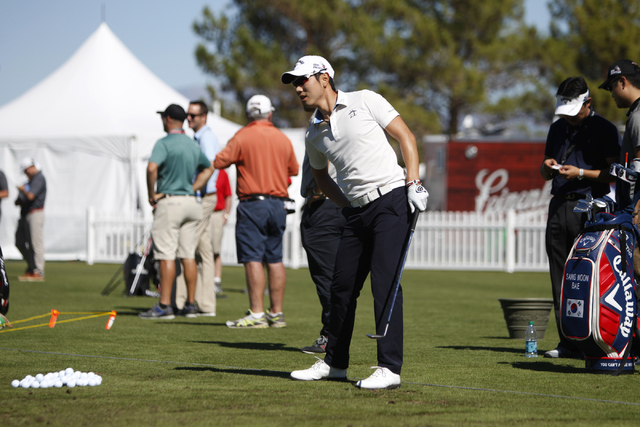 Sang-Moon Bae stretches as he gets ready to hit golf balls during his driving range practice at TPC Summerlin, 1700 Village Center Circle, in Las Vegas Tuesday, Oct. 14, 2014. Bae is competing in  ...