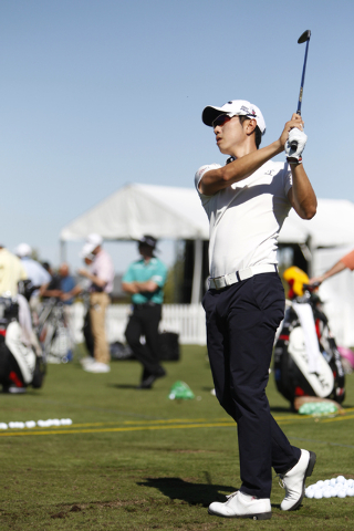 Sang-Moon Bae hits a golf ball during his driving range practice at TPC Summerlin, 1700 Village Center Circle, in Las Vegas Tuesday, Oct. 14, 2014. Bae is competing in the Shriners Hospitals for C ...