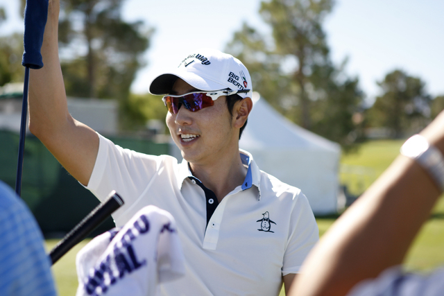 Sang-Moon Bae chooses a golf club for his driving range practice at TPC Summerlin, 1700 Village Center Circle, in Las Vegas Tuesday, Oct. 14, 2014. Bae is competing in the Shriners Hospitals for C ...