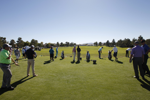 Professional golfers hit balls on the driving range for a practice at TPC Summerlin, 1700 Village Center Circle, in Las Vegas Tuesday, Oct. 14, 2014. Golfers around the world will be participating ...