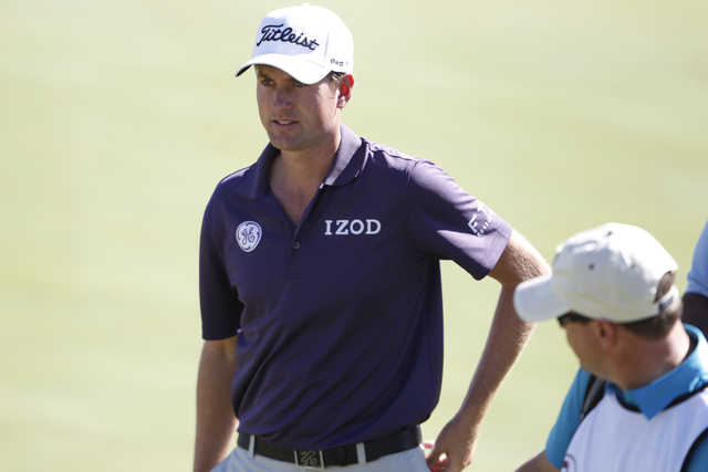 Webb Simpson walks after completing his game on the 18th green during his Pro-Am round in the Shriners Hospitals for Children Open golf tournament at TPC Summerlin, 1700 Village Center Circle, in  ...