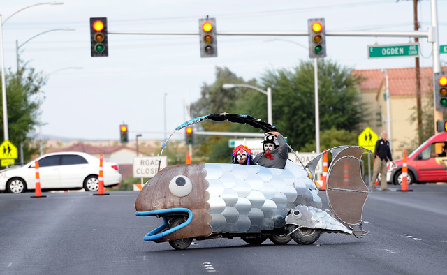 """Trina Medina, left, and Mark Cadrin, guide their """"SidFishes"""" vehicle to the start of the 5th annual Halloween parade along East Fremont Street in Las Vegas on Friday, Oct. 31, 2014. (Dav ..."""