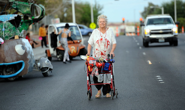 Ines Hellendall of Boulder City, walks up to the starting position before the 5th annual Halloween parade along East Fremont Street in Las Vegas on Friday, Oct. 31, 2014. (David Becker/Las Vegas R ...