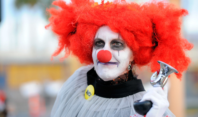 Hilarity Jane blows her horn before the start of the 5th annual Halloween parade along East Fremont Street in Las Vegas on Friday, Oct. 31, 2014. (David Becker/Las Vegas Review-Journal)