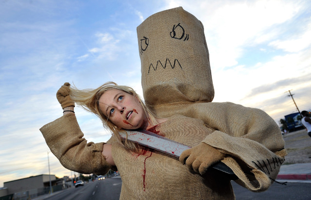 Erica Browning of Henderson, shows off her costume before the start of the 5th annual Halloween parade along East Fremont Street in Las Vegas on Friday, Oct. 31, 2014. (David Becker/Las Vegas Revi ...